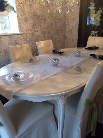 White Dining Table with Six Covered Chairs