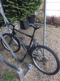 Second hand MountainBike, good condition comes with a locker