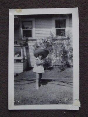 Big Sombrero Hat (YOUNG GIRL WEARING BIG STRAW SOMBRERO  HAT Vintage 1950's)