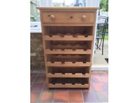 Pine wine rack. Holds 20 bottles. With storage drawer.