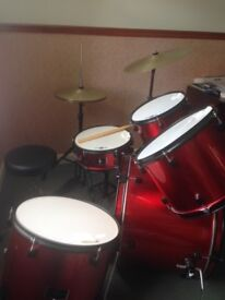 Full drum set and stool, includes cymbals and high hat
