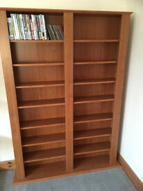 Large DVD/bookcase unit. Sturdy, and offers excellent storage for dvds, Cds, videos or books.