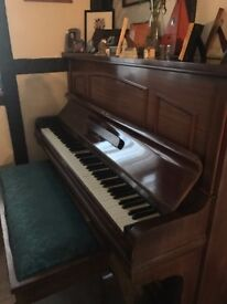 Upright dark wood piano and stool for sale