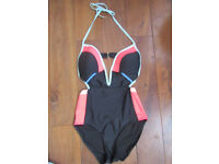 Brand new unused swimsuit in size 12 black with bright colour blocks