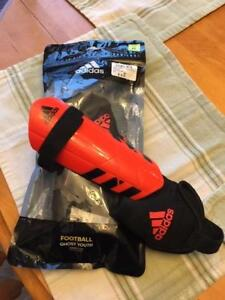 Boys size 3 Adidas soccer shoes and size M shin pads (age 6-9)