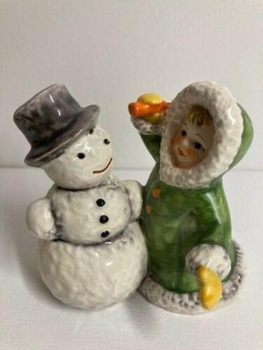 Goebel Wintertime Children Figurine of Girl with Snowman in Green Coat, 11705