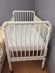Solid wood crib and brand new baby accessory items for sale.
