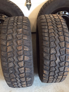 4 studded winter tires on rims P215 70 R16
