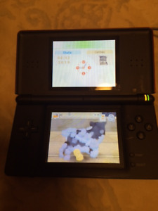 Nintendo DS Lite plus 9 games, charger, cases