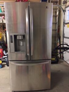 Fridge with bottom freezer.  Stainless steel.