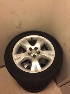 4-Toyota Matrix P205/55R16 all season tires on Factory Alloy rim