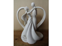 Couple and heart wedding cake topper / anniversary figurine.