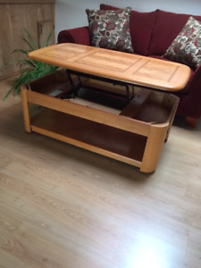 Coffee table with desk height adjustment. One matching side tabl