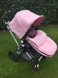 Bugaboo Pram and new born car seat. Very good condition complete with Pink muffin cover