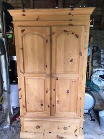 Pine wardrobe with drawer.