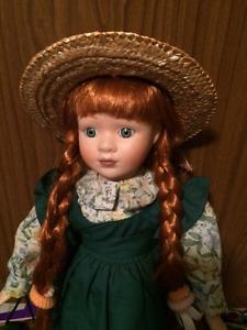 Ann of Green Gables porcelain doll on a wooden base