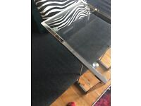 Glass side table which also slides over sofa or chair.