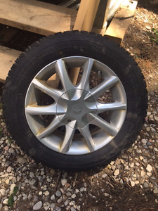 Alloy rims and winter tires from a 2013 Fiat 500 Lounge