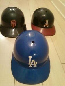 Three replica Major League baseball batting helmets