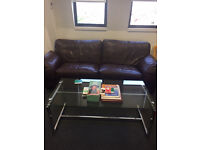 Beautiful soft leather three seater sofa, plus glass/chrome coffee table both in pristine condition.