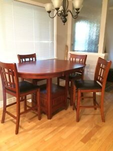 Red Oak Table with leaf and Four Counter-Height Chairs