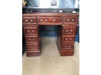 Dark red leather top writing desk