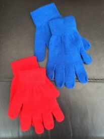 2 pairs of kids gloves, red ones worn once, blue are brand new.