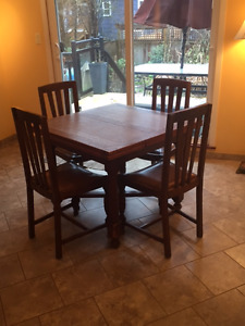 ANTIQUE DINING SET WITH EXTENSION LEAFS AND ROUND TOP OPTION