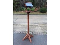 Bird table crafted with slate roof
