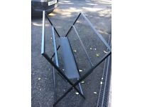 Black wrought iron foldaway print browser for displaying mounted or framed art. Good condition