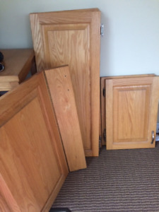 17 solid oak cabinet doors and 4 drawer fronts
