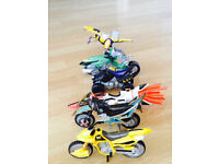collection of 5 power rangers bike figure( one handle missing from 3 bikes)