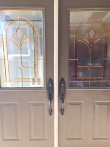Double doors complete with decorative inserts / locksets