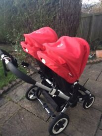 Bugaboo Donkey pram with various accessories and wheelboard