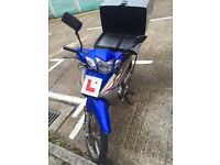 Wuyang 125cc bike in good condition having pizza delivery box.