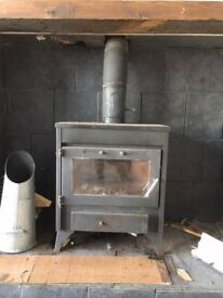 Wood burning stove with flue pipe
