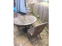 Teak garden table, 3 chairs, umbrella