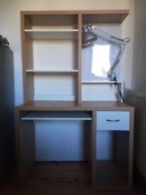 Desk, chair, and lamp setup