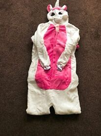 Brand new unicorn onesies with horn tail and button fastening size xl