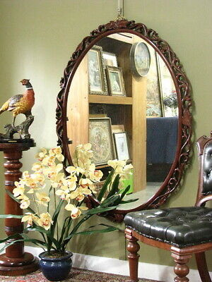 LARGE OVAL WALL / OVERMANTLE MIRROR WITH FINELY CARVED ROSEWOOD FRAME.  c2000s
