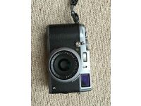 Fuji X100S mirrorless 16MP XTRANS sensor as new with leather wrist strap and spare battery