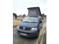 VW camper. 2 berth; 4 seats; 2 boards for bed in raised roof. Ready to go. loads of accessories