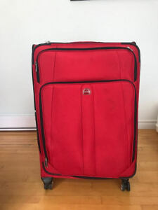 DELSEY Lightweight Luggage / valise  used once