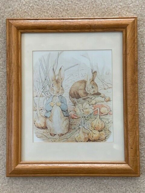 2 used Peter Rabbit framed pictures by Beatrice Potter