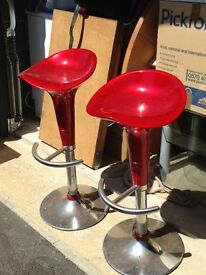 Red and Chrome Swivel Bar Stools in good condition, with feet bar