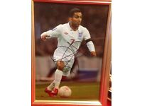Framed signed photo of Aaron Lennon in England strip with certificate of authenticity