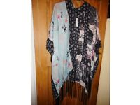 Brand new with tags one size shawl of mixed colours ideal present