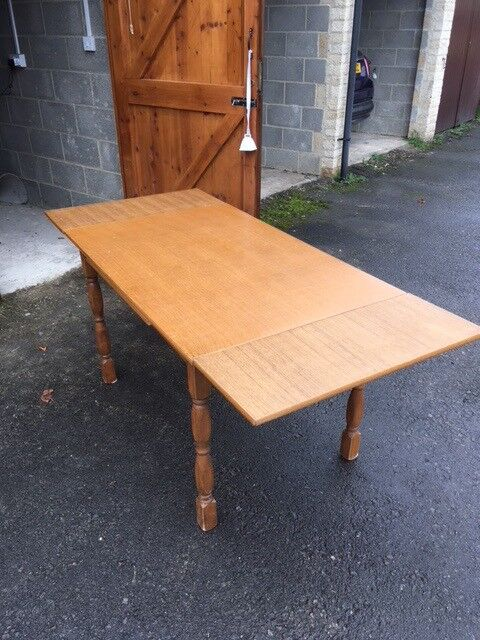 Extendible wooden dining table - can deliver locally for small cost