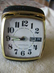 Westclox Travel Alarm Clock black leather w/gold trim, date, day, and time.50's?