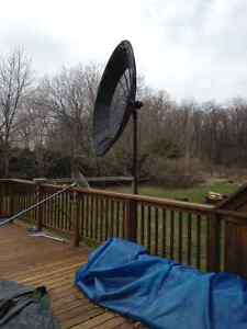 Large Satelitte dish wired with black hose for pool solar heater
